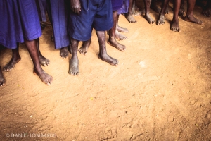 Barefoot students at St. Stephens Buloosi Primary School in Bumula, Kenya.  Photo by Daniel Lombardi.